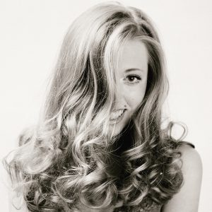 Picture of blonde woman with volume in hair