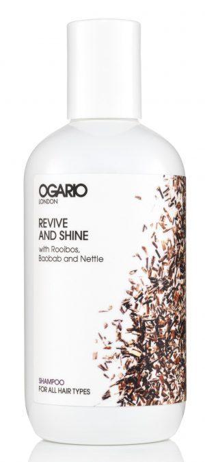 bottle of ogario revive and shine shampoo on white background
